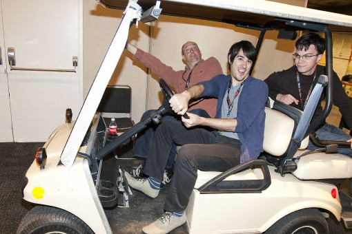 """Adventure Time"" cast and writers Bill Salyers, JG Quintel, and Sam Marin hang out on a go-kart at New York Comic Con on Sunday, Oct. 16, 2011 in New York, NY. Photo by John Nowak/Cartoon Network"