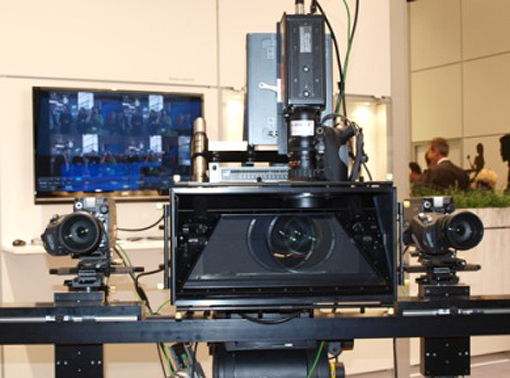 This futuristic system captures live HD footage with a wide-baseline multi-camera rig and estimates the depth map of the captured video streams based on which content is generated and presented on auto-stereoscopic 3D displays.