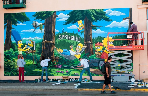 THE SIMPSONS:  Springfield, OR mural artists put the finishing touches on the new THE SIMPSONS mural celebrating THE SIMPSONS 25th ANNIVERSARY during the unveiling of the Simpsons mural dedication ceremony on the downtown walk of murals on Monday, Aug. 25th. THE SIMPSONS ª and © 2014 TCFFC ALL RIGHTS RESERVED.