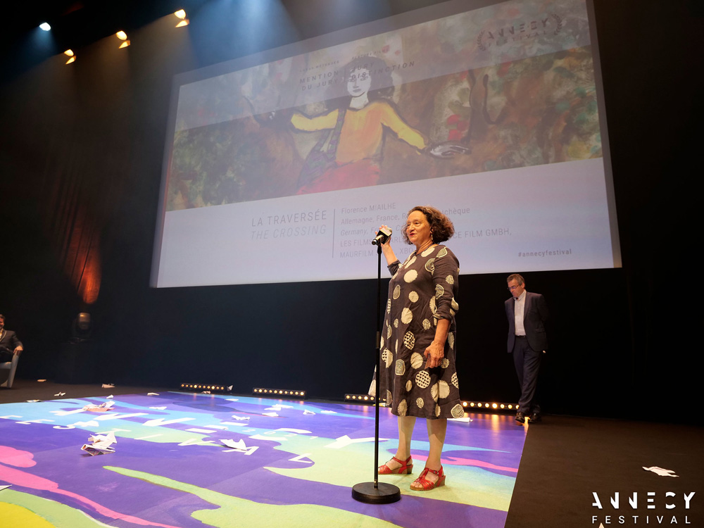Florence Miailhe accepts the Jury Distinction for a Feature Film for The Crossing, 2021 [photo: Annecy Festival/G. Piel]