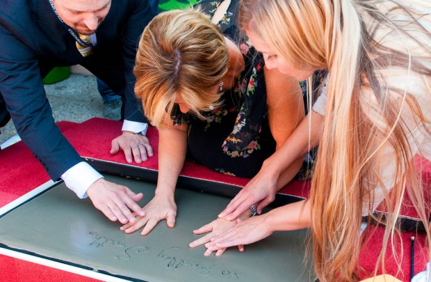 The new Simpsons mural is unveiled in a public ceremony in downtown Springfield Oregon on August 25th, 2014. In attendance were city dignitaries, the general public, and the voice of Lisa Simpson, Yeardley Smith.