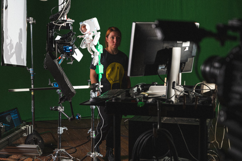 Host Anna Polisnka shoots one of the space scenes for Astra.