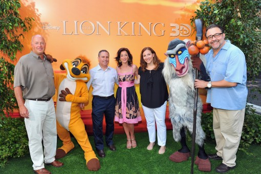 "HOLLYWOOD, CA - AUGUST 27:  (L-R) President of Walt Disney Studios Home Entertainment Bob Chapek, President of Walt Disney Studios Alan Bergman, actress Moira Kelly, Walt Disney Studios Home Entertainment's Lori MacPherson and producer Don Hahn pose with Timon and Rafiki at ""The Lion King"" Los Angeles 3D Premiere at the El Capitan Theatre on August 27, 2011 in Hollywood, California.  (Photo by Alberto E. Rodriguez/WireImage)"