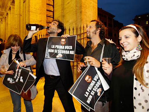 Opponents of Berlusconi celebrate his conviction for tax fraud; photo courtesy of The Guardian