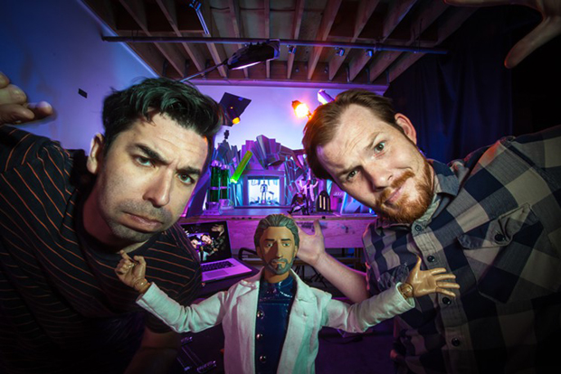 Creators Carlo Moss, left, and Mark Cope with series protagonist Dr. Havok