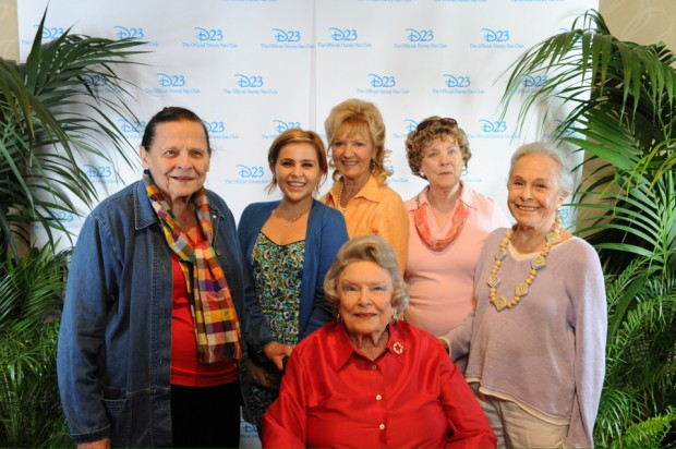 "Ginni Mack (in red), surrounded by the ""Tink Ladies"": Alice Davis (wife of character creator Marc), Mae Whitman (current voice of Tinkerbell), Kathryn Beaumont and Margaret Kerry (live-action reference models for Tink) and Marge Champion (reference model for Pinocchio's Blue Fairy). © Disney, courtesy D23 2012"