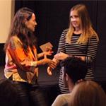 Ellie Baily Jones accepts REACT award