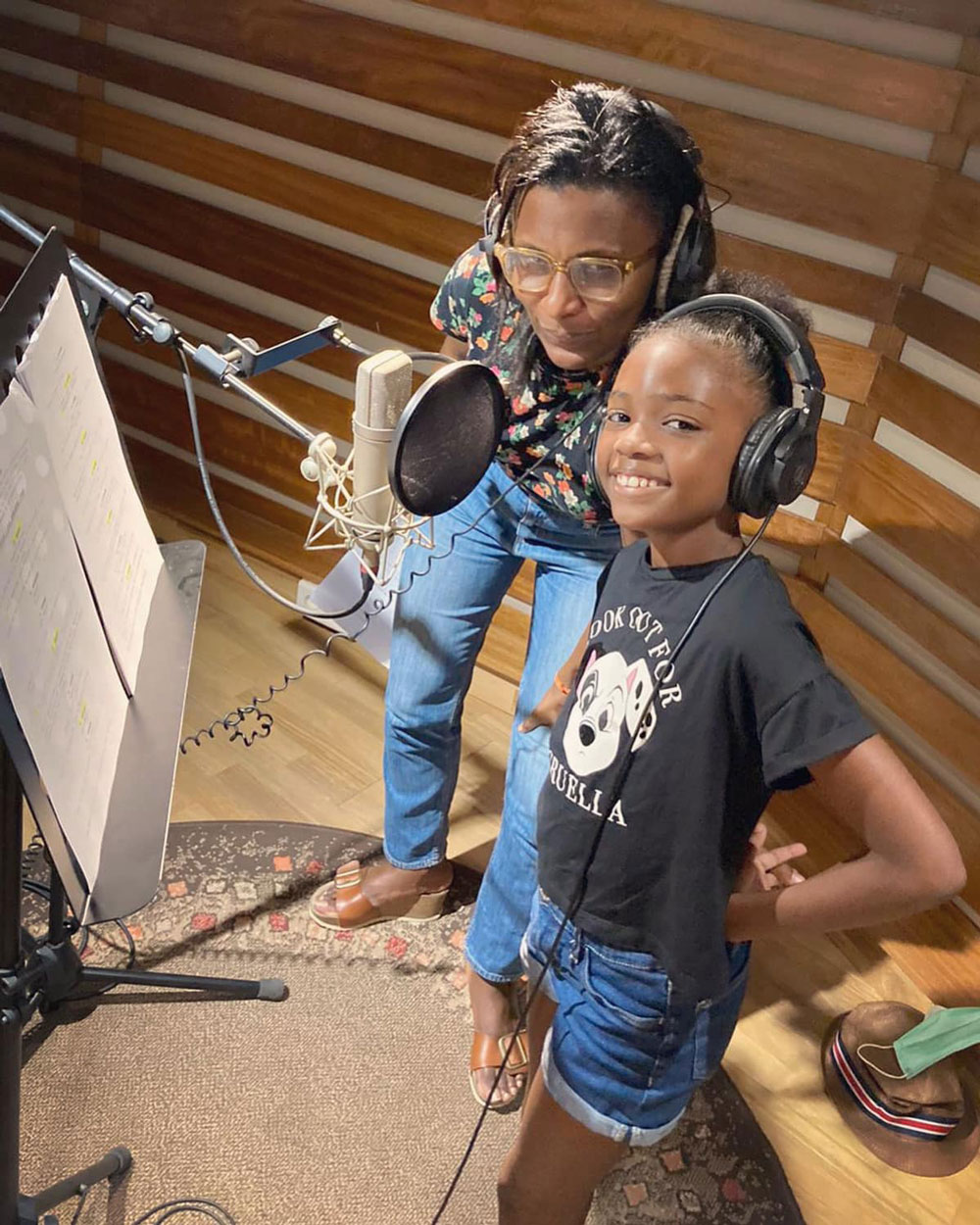 Creator Marguerite Abouet (left) recording with one of the special's young stars.