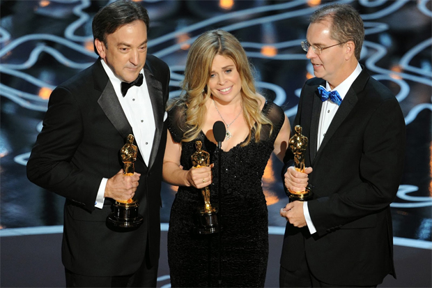 (from left) Producer Peter del Vecho, and directors Jennifer Lee and Chris Buck, accepting the Best Animated Feature Oscar for Frozen