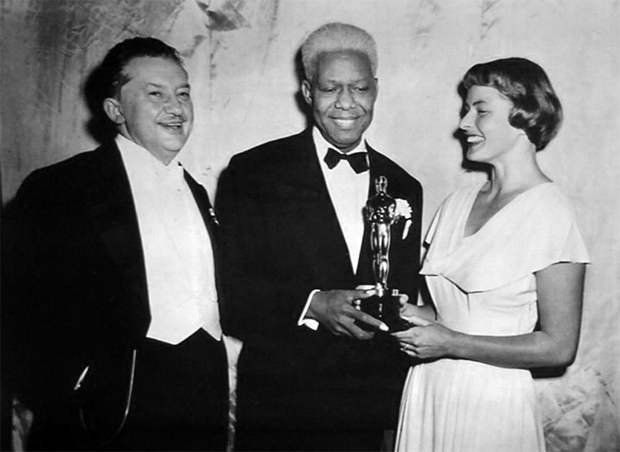 James Baskett receives a special Oscar for his performance as Uncle Remus in Song of the South