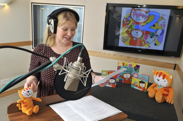 Joanna Page recording the voiceover for Poppy Cat at Ftizrovia Studios. Pictured in the sound studio, edit suite and with Poppy Cat toy in reception area. Also in the photos with Joanna are Coolabi CEO Jeremy, FD Tim and art director Leo, 4th December 2013. Photography by Fergus Burnett