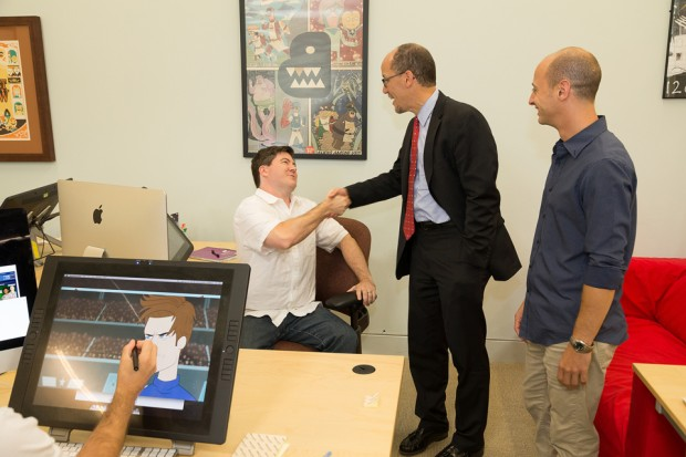 Art Director David SanAngelo, left, U.S. Secretary of Labor Tom Perez and Art Director Aaron Hawkins. Both Hawkins, who lead the tour of the studio on Aug. 22, and SanAngelo were hired as part of the OJT program, a federally funded program that is administered locally.