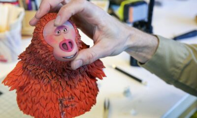 A LAIKA animator adjusts Susan's expression while filming Missing Link [Photo: Laika Studios / Annapurna Pictures]