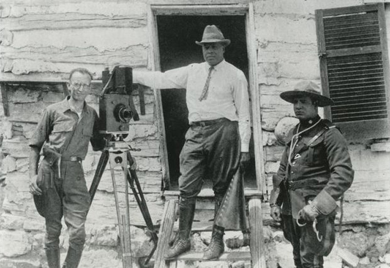 Pioneering African-American director and studio founder Oscar Micheaux (center) on set. [Photo: New York Public Library, Schomburg Center for Research in Black Culture]