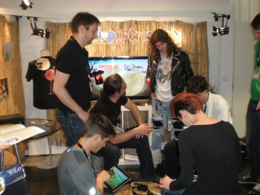 """FMX attendees test the new Plop the Croc game, """"Rollin' Wild: The Game."""""""