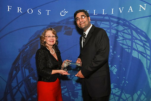 Toon Boom's president and CEO Joan Vogelesang recieves the Frost & Sullivan Award for Entrepreneurial Company of the Year