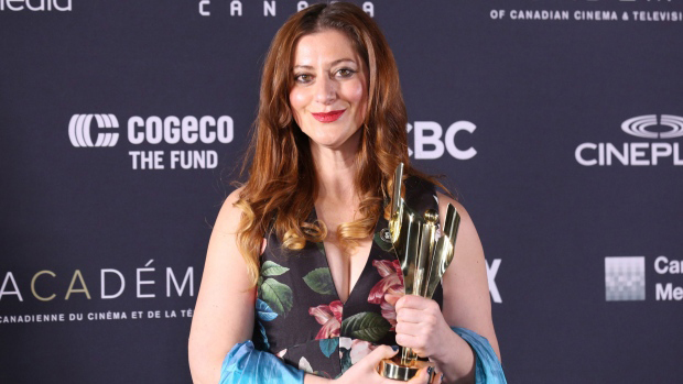 Anita Doron, winner of Best Adapted Screenplay for The Breadwinner, poses backstage at the 6th Canadian Screen Awards in Toronto. [Photo: The Canadian Press/Peter Power]