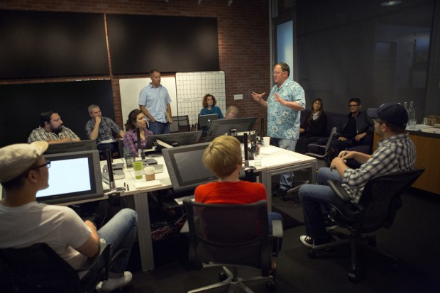 "Director John Lasseter works with members of his story team on Disney-Pixar's ""Toy Story 4,"" a new chapter in the lives of Woody, Buzz Lightyear and the ""Toy Story"" gang. The film is slated for release on June 16, 2017. (Photo by Deborah Coleman / Pixar)"