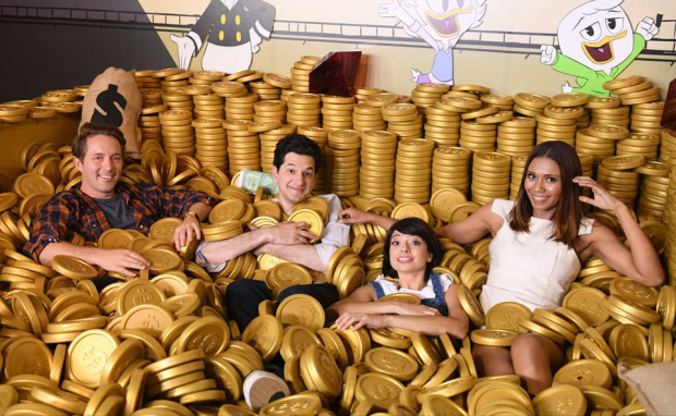 The cast of the new DuckTales hang out in the money bin at D23 Expo 2017. L-R: Beck Bennett (Launchpad), Ben Schwartz (Dewey), Kate Micucci (Webby) and Toks Olagundoye (Mrs. Beakley).