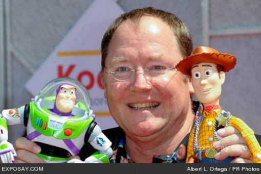 John Lasseter poses with Buzz and Woody.