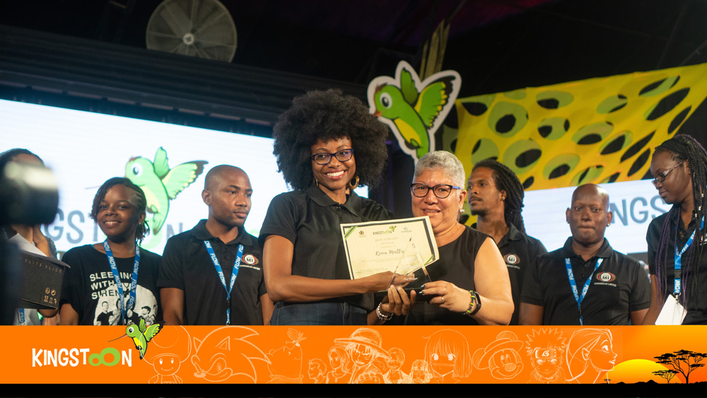 Pitch winner Kenia Mattis, CEO - ListenMi Caribbean (Center Left) with Jacqueline Lynch Stewart, Chief Technical Director - Office of the Prime Minister (Center Right)