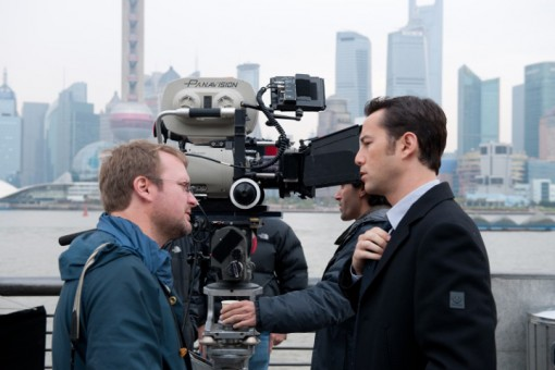 Writer-director Rian Johnson and Joseph Gordon-Levitt (Joe), made up to look like a younger Bruce Willis (Old Joe), on location in Shanghai. Photo by Alan Markfield. Courtesy of Sony Pictures. Copyright © 2011 – Looper, LLC