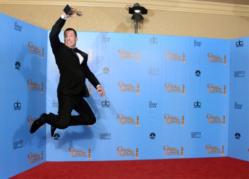 Mark Andrews leaps with his award at the 70th Annual Golden Globe Awards.