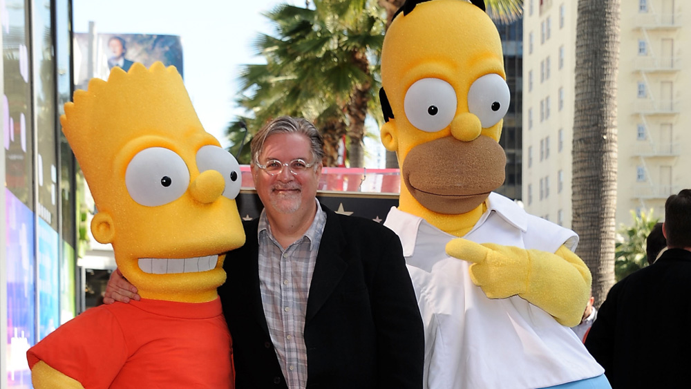 Matt Groening (center) poses with Bart and Homer Simpson [Photo: Valerie Macon/Getty Images]