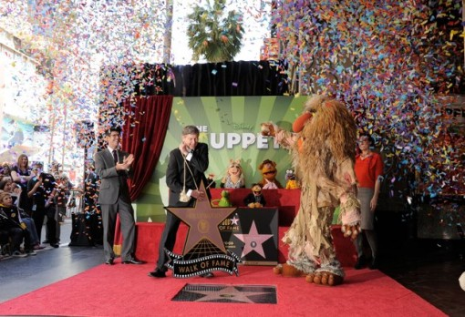 (L-R) Walt Disney Studios President Rich Ross, Hollywood Chamber of Commerce President/CEO Leron Gubler and the Jim hensonCompany CEO, Lisa Henson attend the star unveiling for The Muppets who were honored with 2,466th Star on the Hollywood Walk of Fame in front of the El Capitan Theatre on March 20, 2012 in Hollywood, California. (Photo by Frazer Harrison/Getty Images)