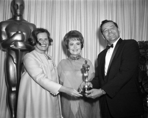 John and Faith Hubley receiving an Oscar from Olivia de Havilland
