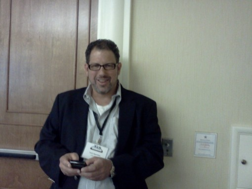 Frank Saperstein, senior VP of Entertainment One, downloads a few new apps during a coffee break.